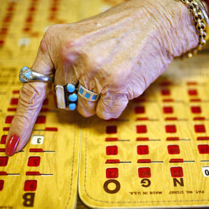 B. Ann Bower marks off a number on one of her boards during the regular Friday afternoon gathering of the Murphsyboro Senior Citizen Center Bingo Club. (Photo by Anthony Souffle)