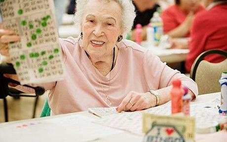 Smiling woman playing bingo